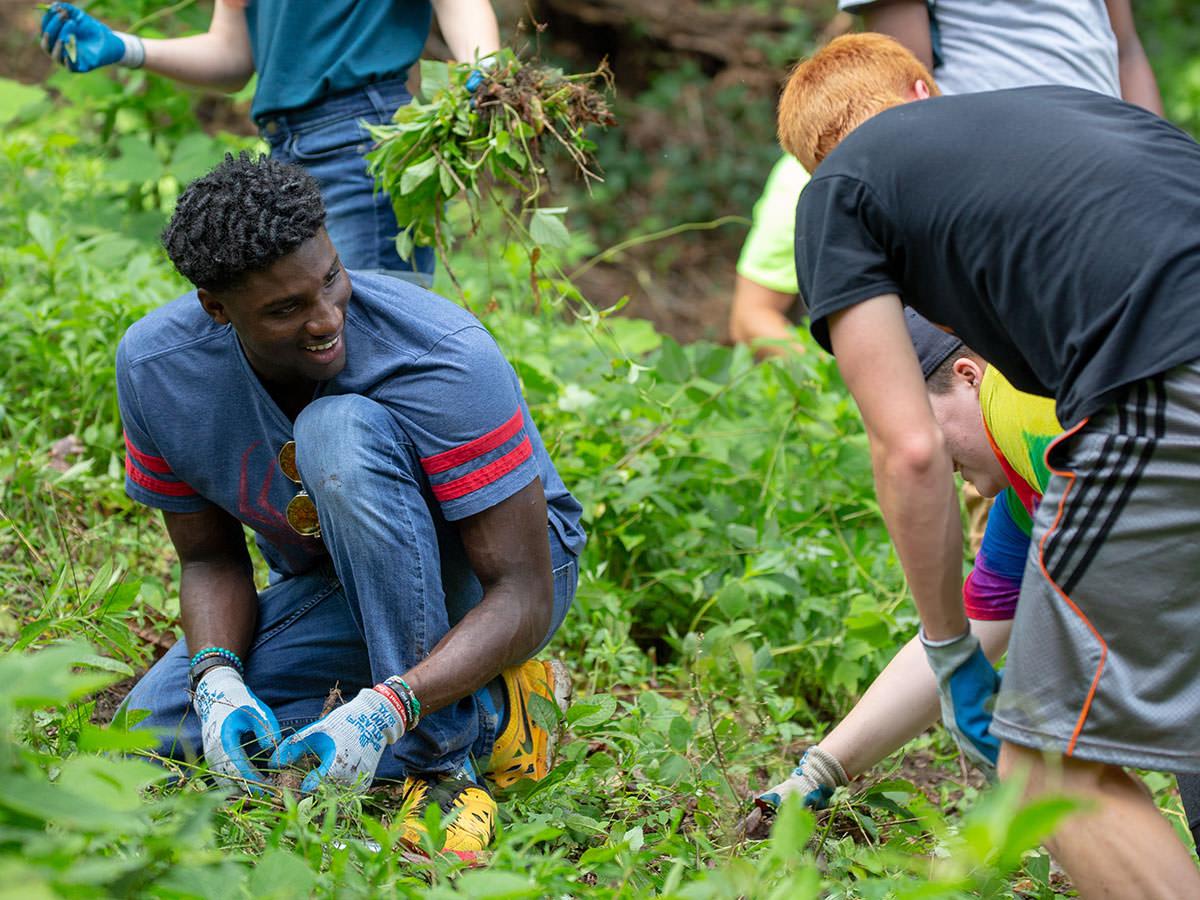 Youths working in garden